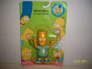LAST BUT NOT LEAST, IS A BENDABLE ACTION FIGURE   {MAGGIE SIMPSON