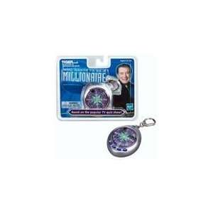 Millionaire Travel Game by Tiger Electronics  Toys & Games