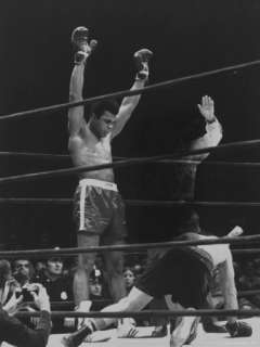 Ali Raising His Gloves Victoriously After Knocking Out Oscar Bonavena