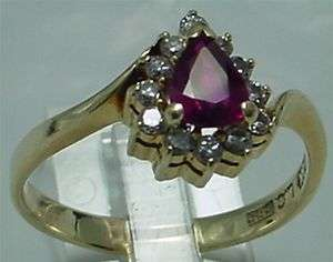 14 KARAT YELLOW GOLD RUBY & DIAMONDS RING IN EXCELLENT CONDITION